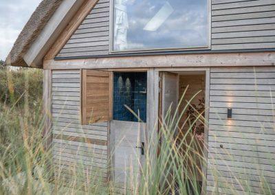 Luxe vakantiehuis de Duunglop Ameland buitendouche deur